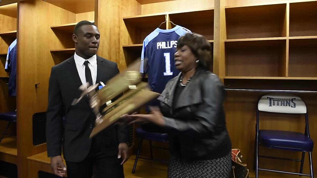 Jacob Phillips' mom almost drops his Mr. Football trophy