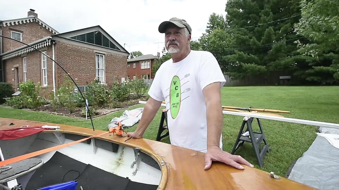 John Guider on the boat he used to retrace history