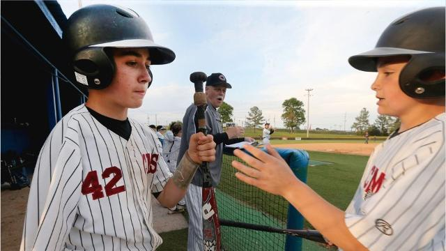Video: One-armed catcher excels on baseball diamond