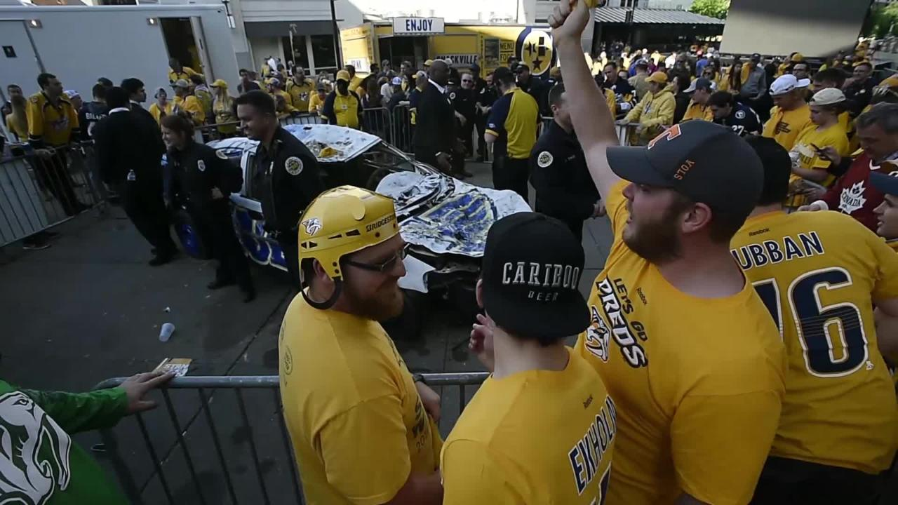 Nashville Predators fans beg to flip the Blues Smash car after historic win