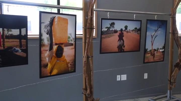 A collection of photos is seen at the Yida photography exhibit by Operation Broken Silence.