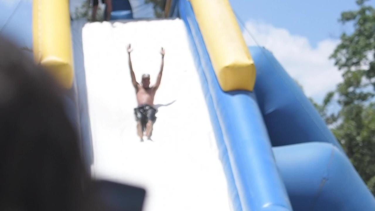 Chance the Rapper goes down Bonnaroo's giant water slide