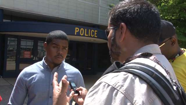 Protester files complaint after officer pushes him
