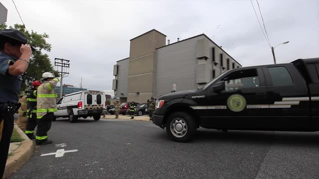 Raw Video: Motorcade brings fallen firefighters to medical examiner's office