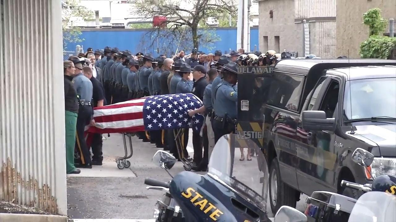 Trooper's body arrives at medical examiner's office