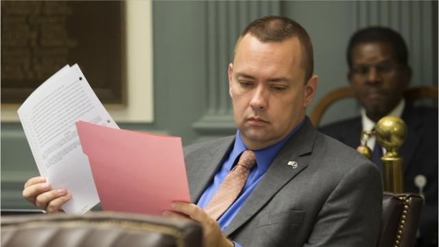 State Senator misses flight when gun found in carry-on