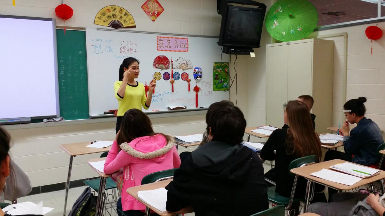 Students learn Chinese as teacher Jesse Lin reviews a recent test.