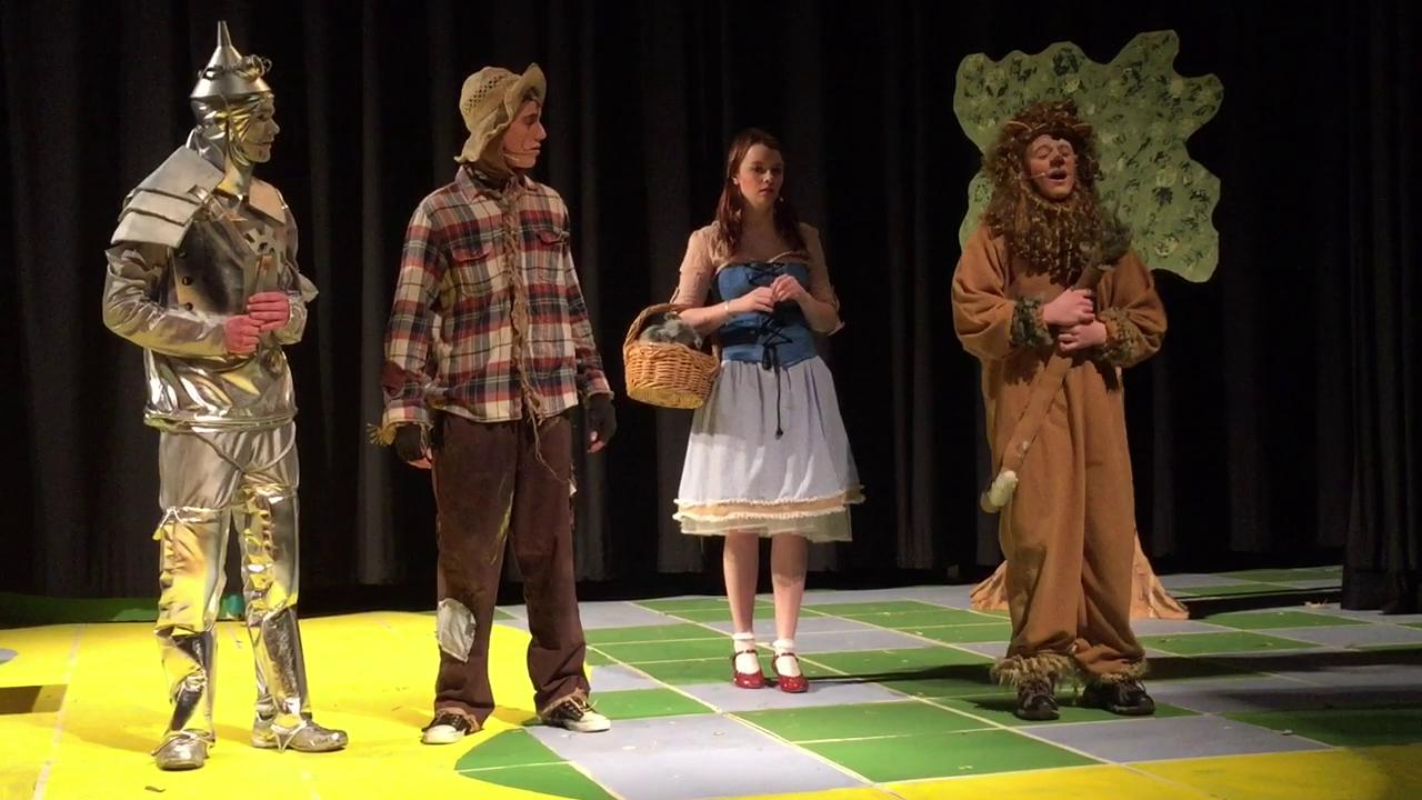"""Christa Lain as Glenda and Lauren Hire as the Wicked Witch of the West tease each other. """"The Wizard of Oz"""" at Coshocton High School also features Lauren's sister, Madeline, as Dorothy. Lauren and Madeline also talk about the show."""