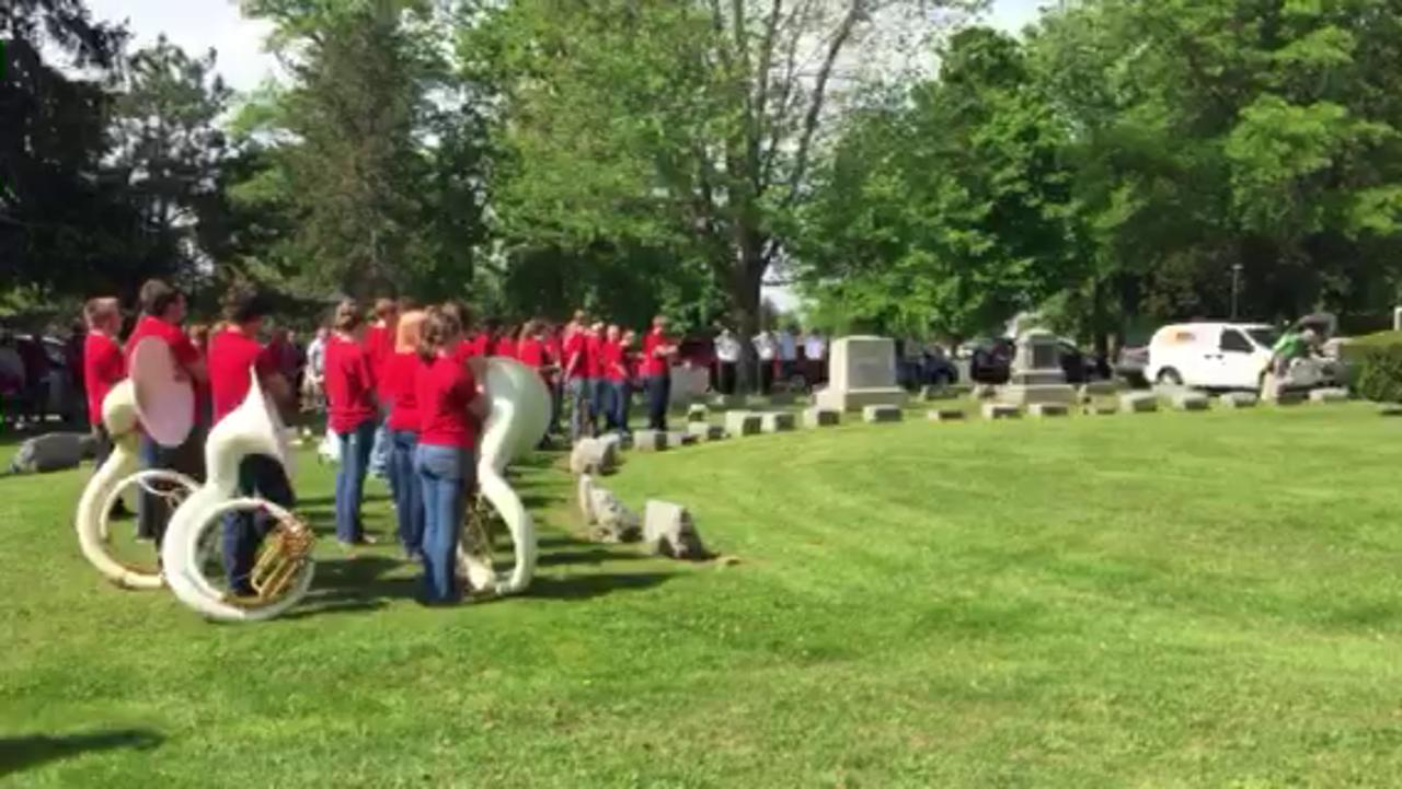 The Honor Guard, American Legion Post 181, Bucyrus, fires a salute to the dead, followed by a playing of taps by members of the Bucyrus High School Band, Monday to conclude Memorial Day observances at Oakwood Cemetery, Bucyrus.