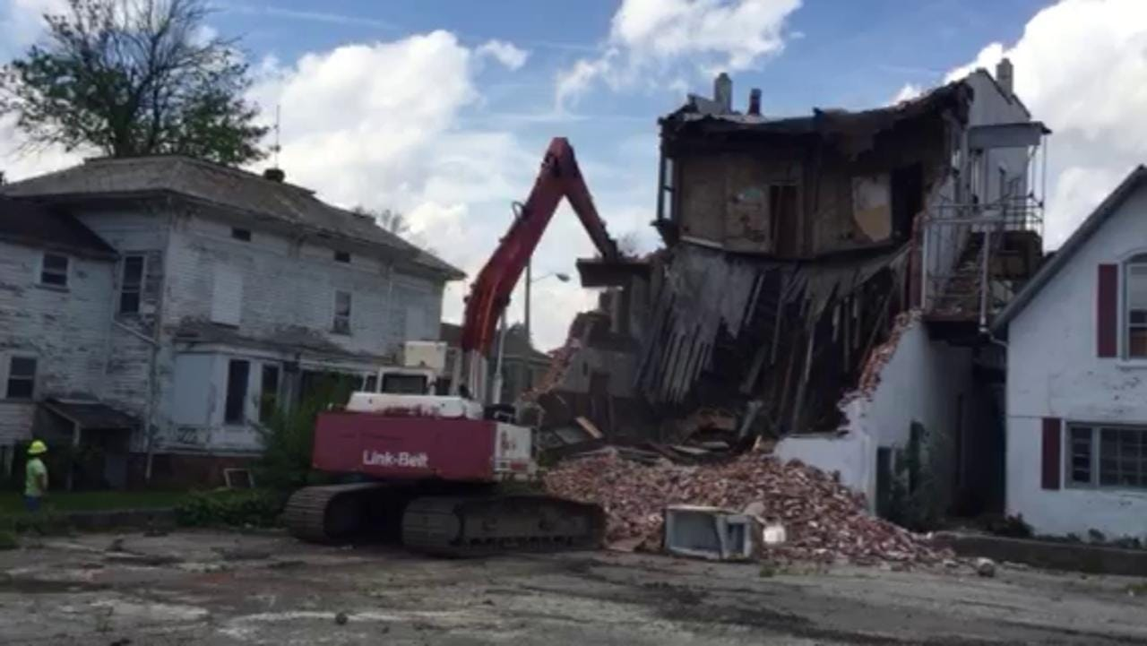Workers with Quinn's of Bucyrus demolish a condemned structure Tuesday at 209 W. Mansfield St., Bucyrus.