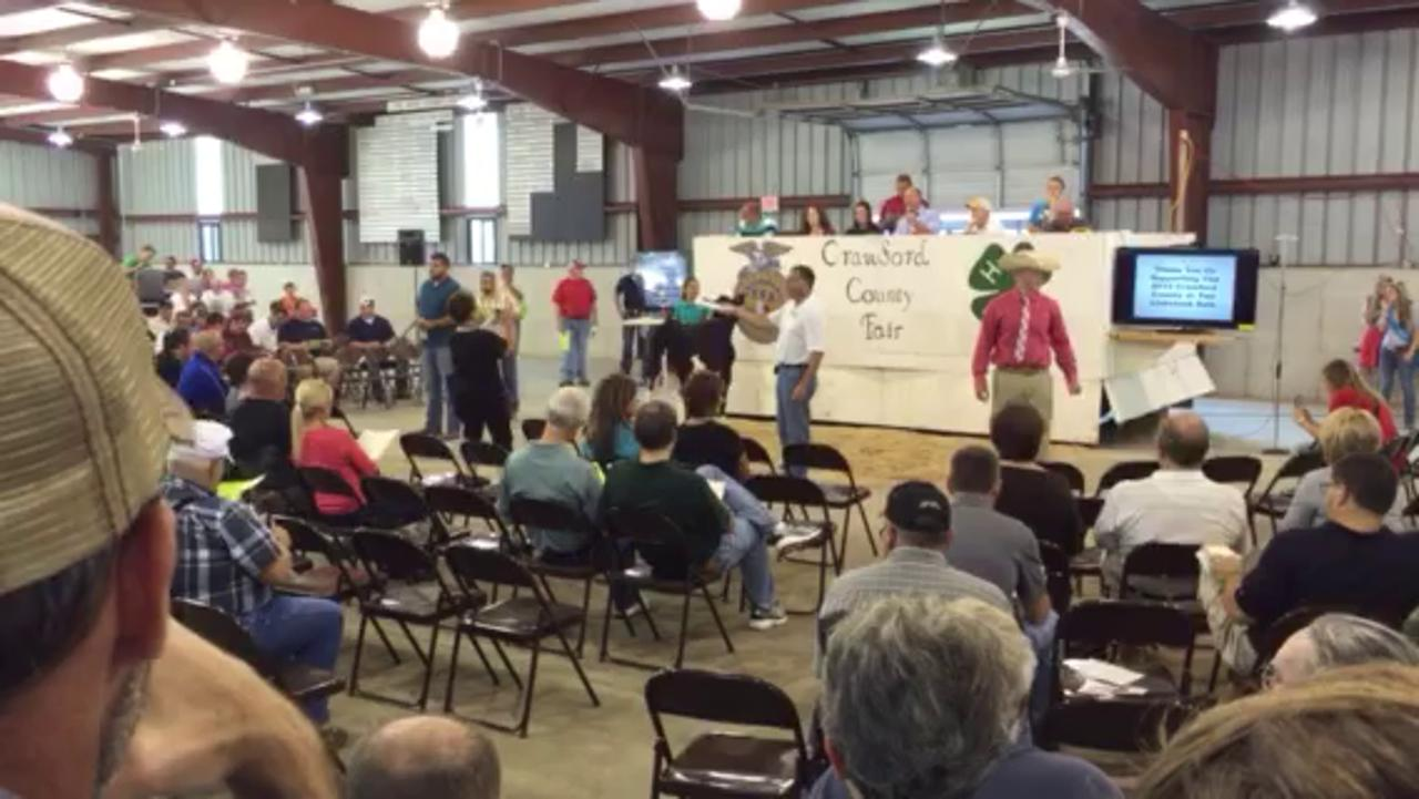 The livestock auction gets underway Saturday at the Crawford County Fair in Bucyrus.