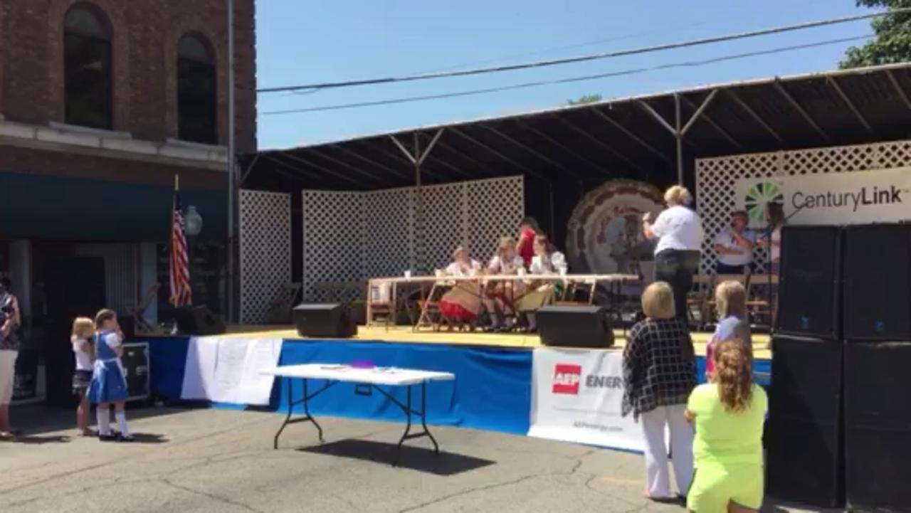 The 2014 Bucyrus Bratwurst Festival Queen, Tessa Starner, center, and her court, compete in a bratwurst-eating contest Thursday. Starner won the competition.