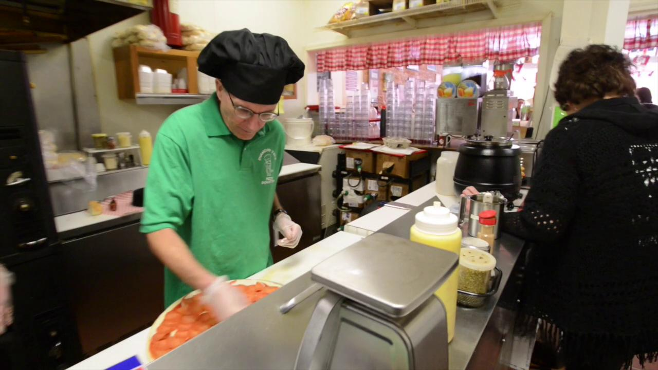 Eagle-Gazette reporter Jeff Barron took a turn in the kitchen at Diamond Jim's Pizza to make a pizza and a sub.