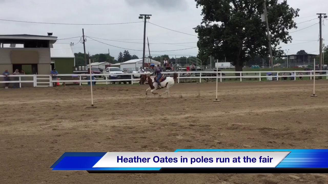 Heather Oates and Tatum Staten showcase their horses during speed competitions Tuesday morning at the Marion County Fair.
