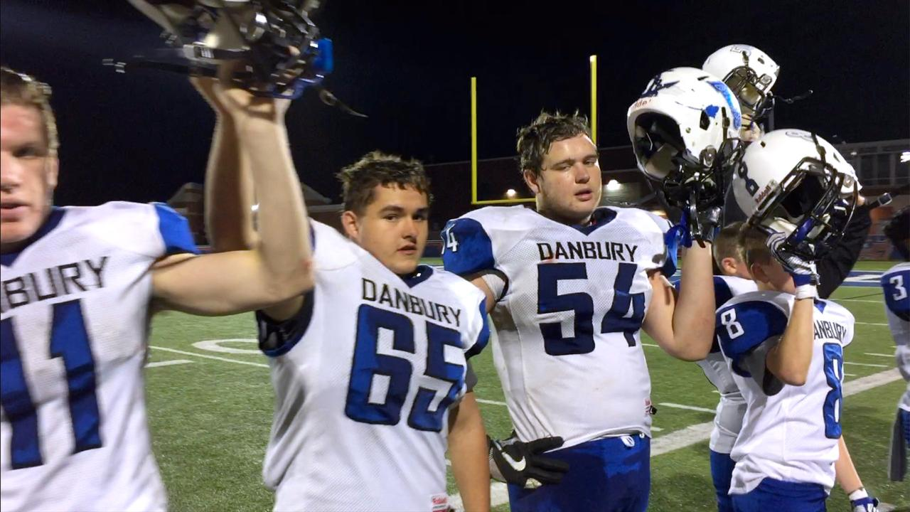 Danbury celebrates defeating Toledo Christian 50-7.