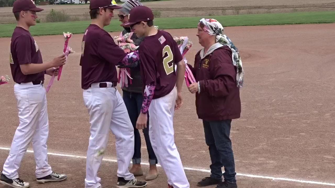 Licking Heights' JV baseball team had a Strike Out Cancer game Monday to support mothers Faith Weall and Kathy Mahl who are battling cancer.