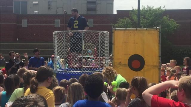 Teachers at Liberty Elementary School in Caledonia worked the dunk tank on May 23 to help raise money for Relay for Life of Marion County. Intervention specialist Kyle Burris wore a University of Michigan football jersey, which drew jeers from the student body. He was dunked on the student's first throw.