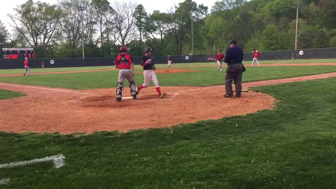 Coshocton's Andrew Mason notches a two-run single to cut the gap to 5-3 against Tusky Valley.