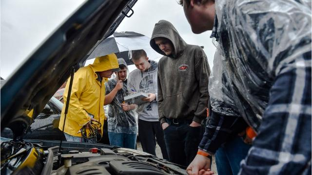 Students learn from AAA representatives proper vehicle safety and maintenance.