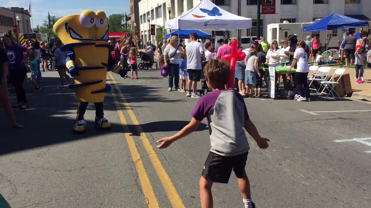 Simeon Marshall, 9, from Lancaster decided to challenge Gusto, the Lancaster High School mascot, to dance-off during the United Way of Fairfield County's Day of Action.