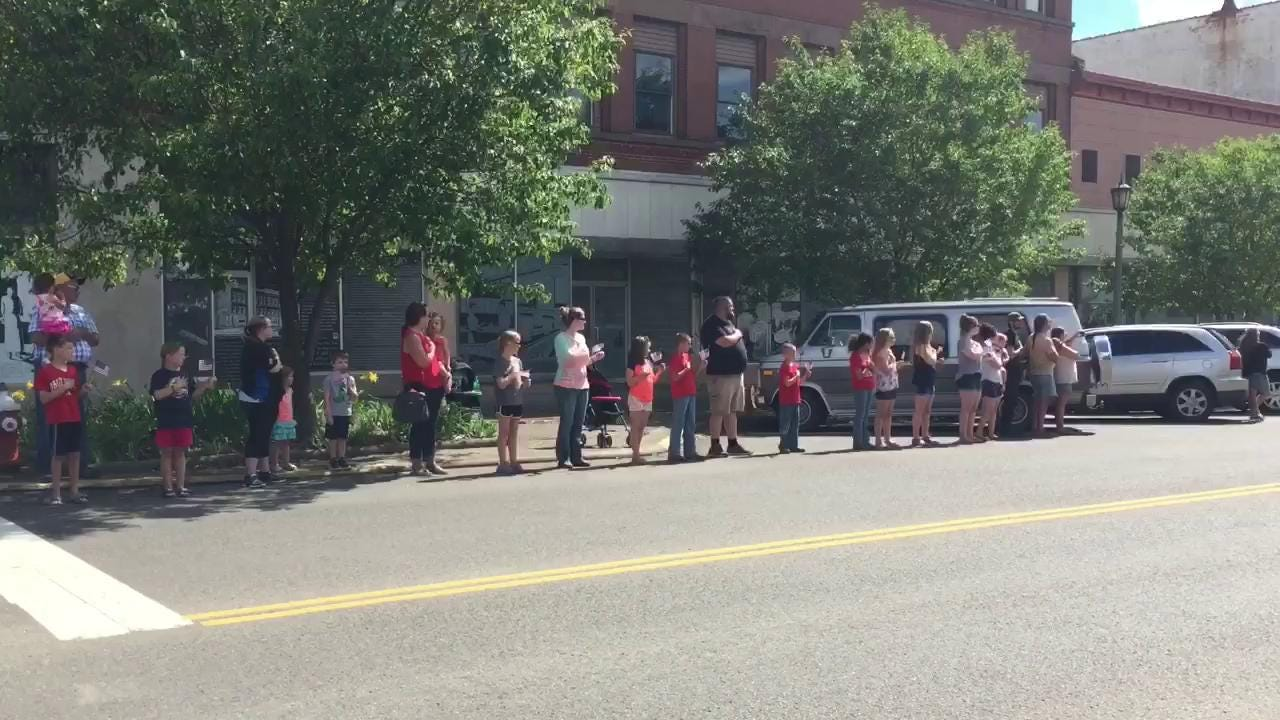 A procession for the late Pvt. Eugene Appleby, killed during WWII, makes its way down Main Street in Coshocton.