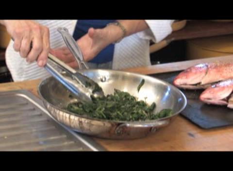 Cooking School: Celia Casey prepares flambeed red snapper.