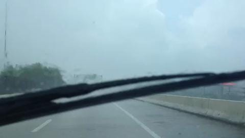 A heavy deluge of rain slows traffic along I-110 in Pensacola Thursday.