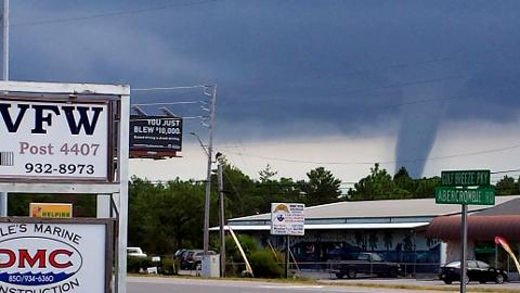 A waterspout forms over the Santa Rosa Sound near Navarre on Tuesday, Sept. 16, 2014.