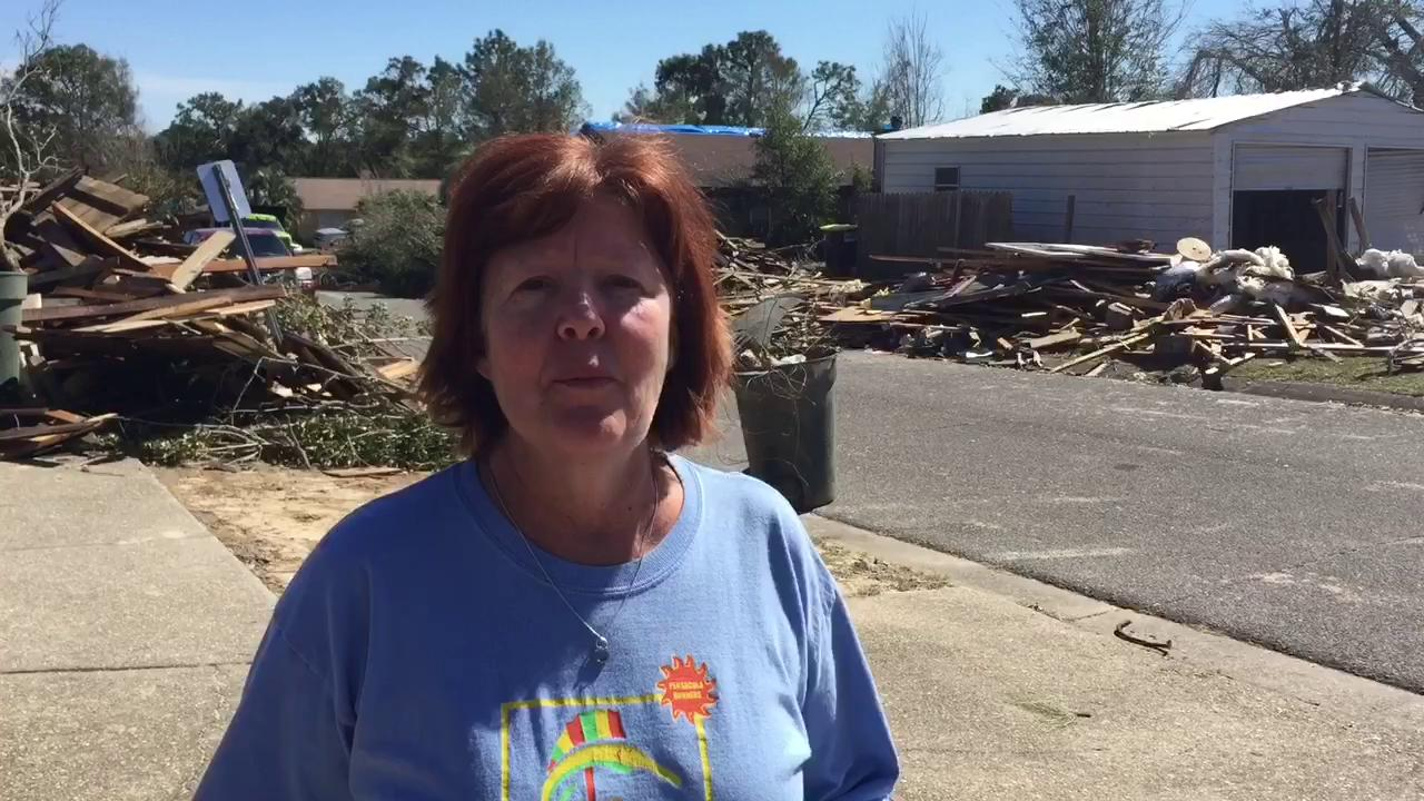 Volunteers with Florida Baptist Disaster Relief help clear tornado debris