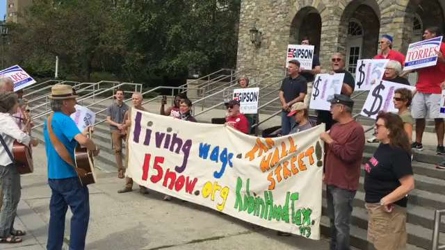 Local residents, elected officials, union workers and activists gathered in front of the post office in Poughkeepsie Monday for the annual Labor Day rally.