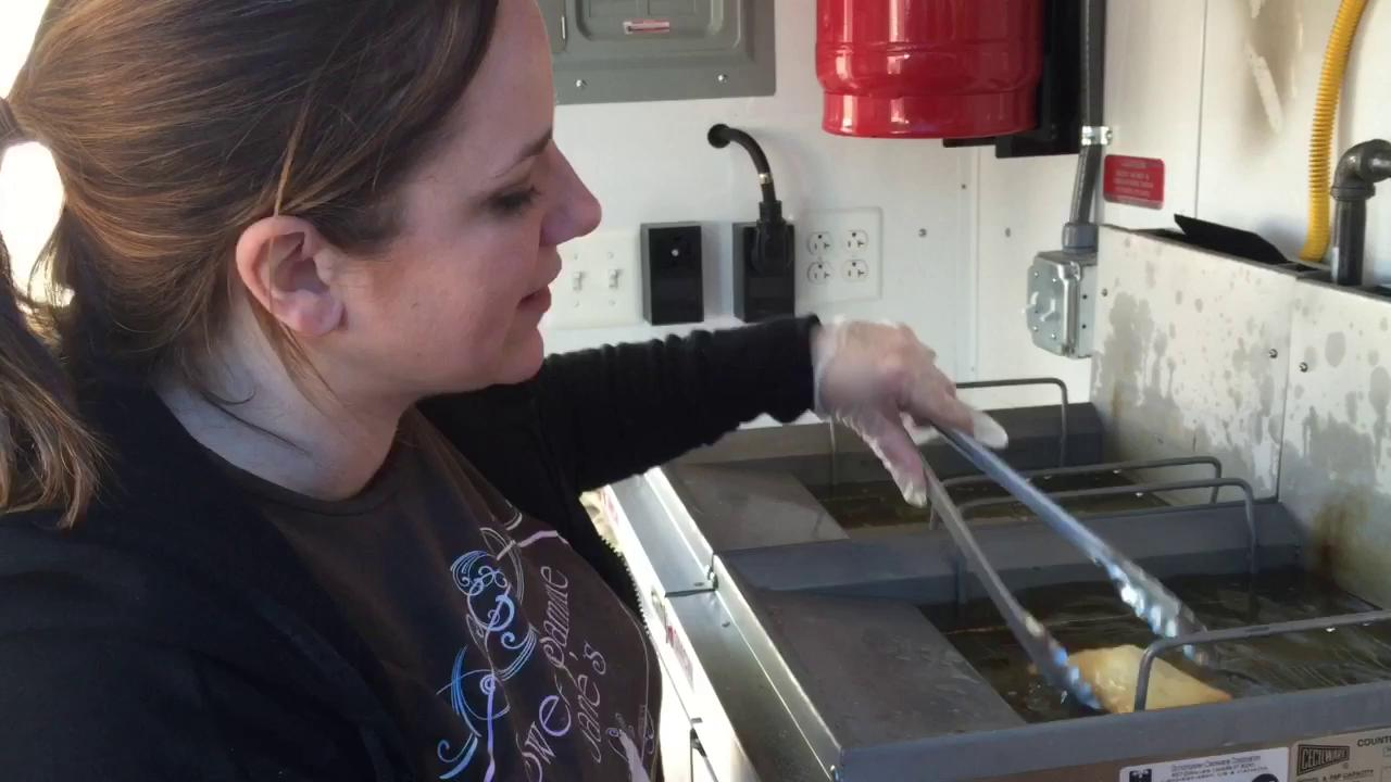 Angela Marmo, co-owner of Sweet Sammie Jane's food truck and bakery, shows how beignets are made.