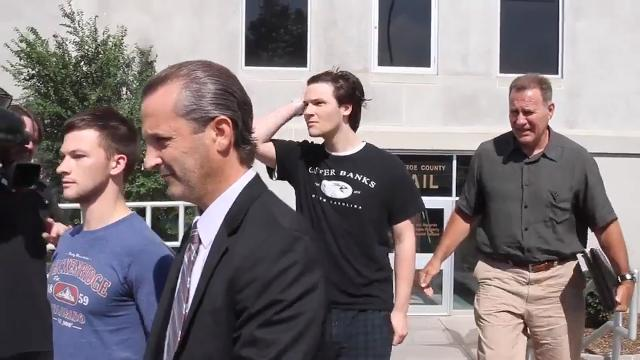 Raw video: Sons of slain Penfield man freed on bail