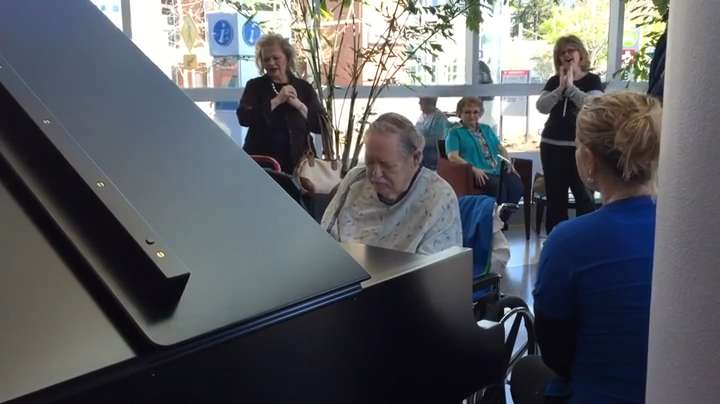 Harry Lawson drew a crowd on March 31, 2016, as he played the grand piano in the lobby of Building A on the campus of Salem Health. Video courtesy of Dr. Everett Mozell.
