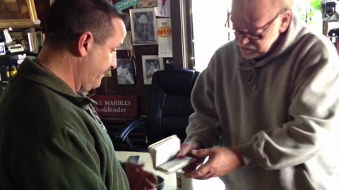Bookbinder helps restore fallen Marine's Bible