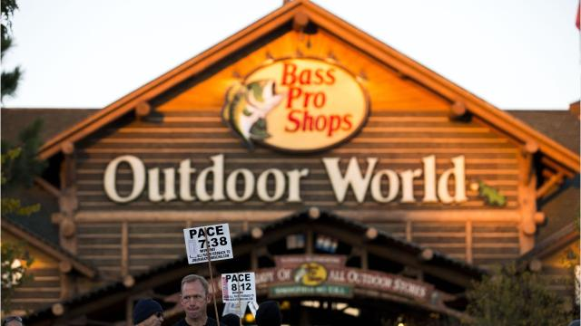 Bass pro shops closes deal to buy cabelas colourmoves