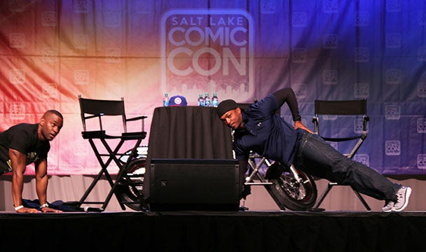 Actor Anthony Mackie competes in an impromptu push-up contest, answers fans' questions at the 3rd Annual Salt Lake Comic Con in Salt Lake City, Utah.