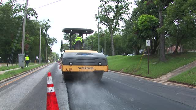 Workers repair roads near Doak