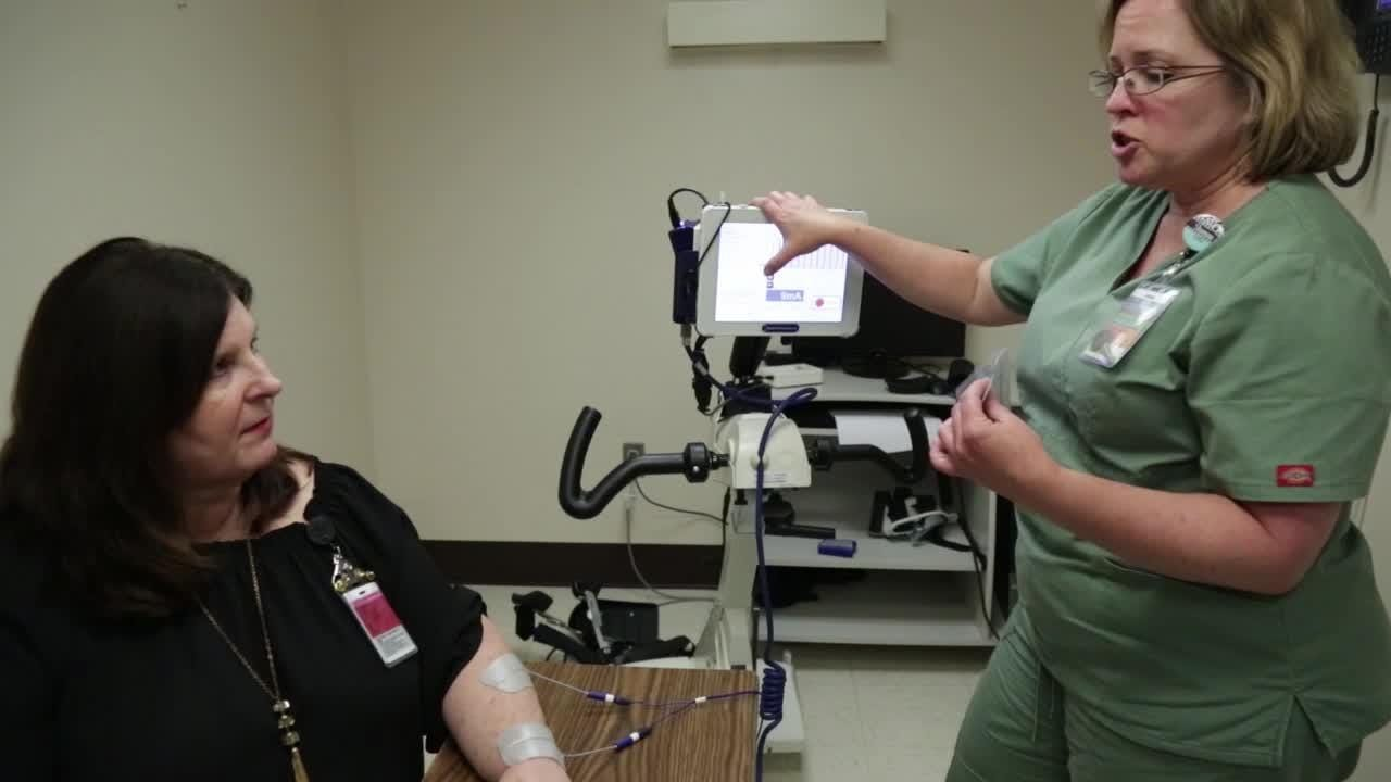 Certified Occupational Therapy Assistant Shannon Zapata and Sheree Porter, rehab program manager at TMH rehabilitation center, neuro rehabilitation, demonstrate equipment used to help patients strengthen muscles they can't control with their brains.