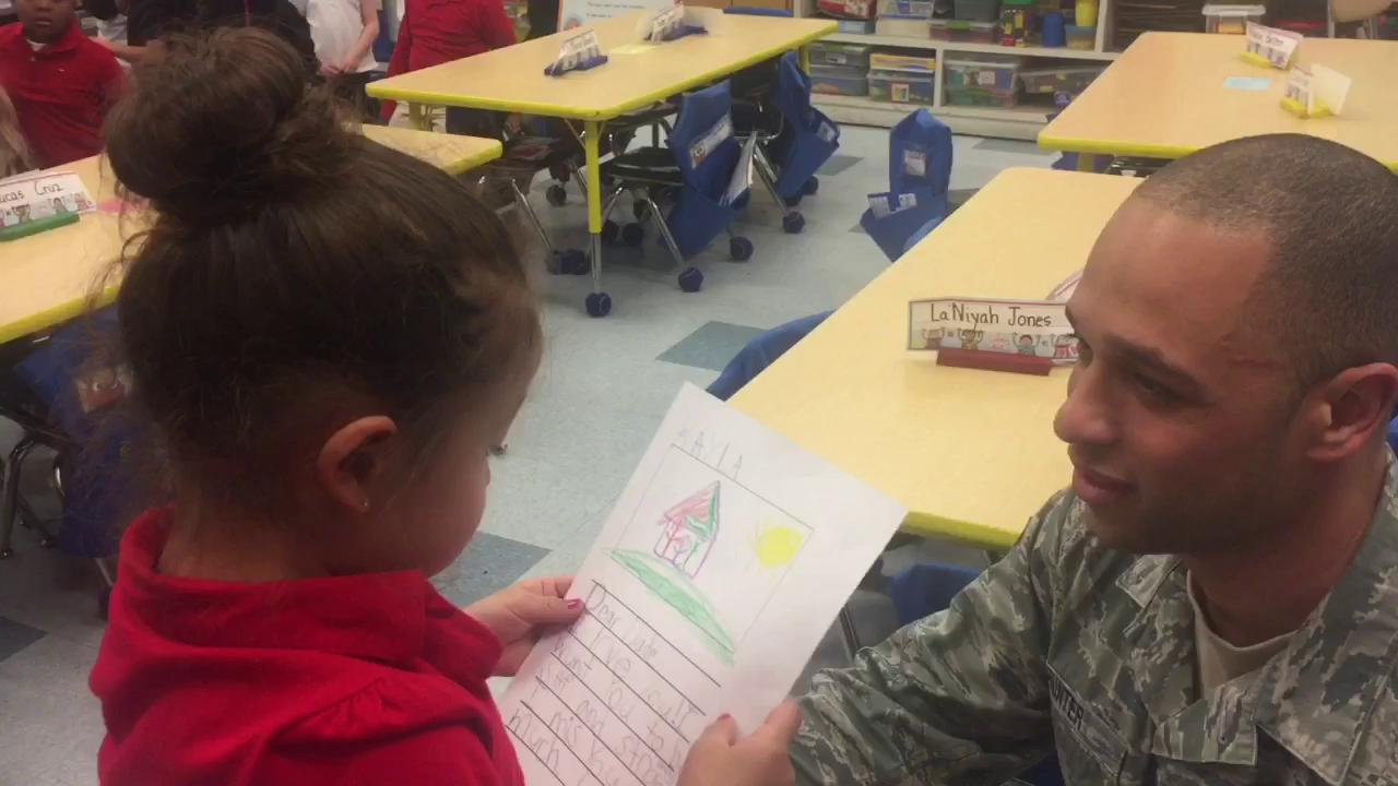 USAF Staff Sgt. Alex Hunter surprised his kindergarten daughter at Winslow Elementary School Tuesday afternoon. He returned home after a 193-day Middle East deployment.