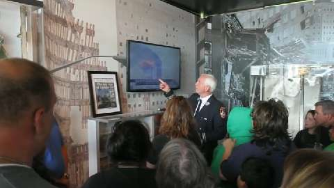 FDNY Captain Peter Wright talks about the 9-11 Stephen Sillar Tunnel to Towers traveling 9-11 memorial museum parked outside Brewster High School Sept. 17, 2014. )Video by Frank Becerra Jr./The Journal News)