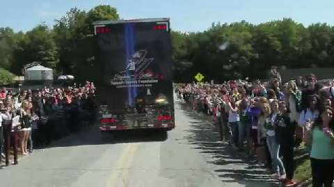 Brewster High School students line Foggintown Road as the 9/11 memorial traveling museum arrives at Brewster High School Sept. 15, 2014. (Video by Frank Becerra Jr./The Journal News)