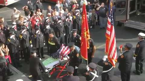 Residents waving American flags line the route as Brewster firefighters escort a piece of steel from the World Trade Center disaster to their firehouse Oct. 21, 2015. The steel will be used as a permanent monument. (Video by Frank Becerra Jr.)