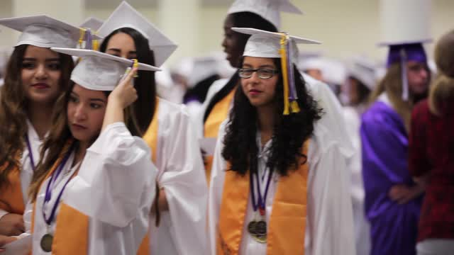 Lincoln High School graduates celebrate their commencement at the Westchester County Center in White Plains, June 26, 2016.