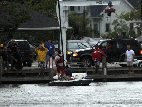 Citizens help rescue victims of boat that capsized on Lake Winnebago northeast of the Lakeside Park lighthouse in Fond du Lac.