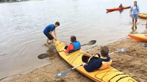 Scores of people with disabilities enjoyed kayaking and volunteers enjoyed helping them Wednesday on the Wisconsin River.