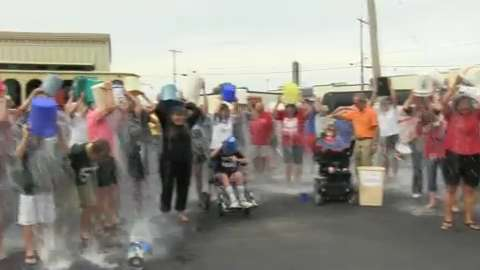 About 50 people participated in a mass ALS Ice Bucket Challenge in Sheboygan to support Wendy Rauwerdink, who has the disease.