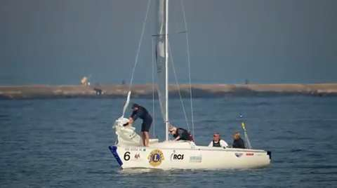Lion BJ Blahnik engaged the Sheboygan Noon Lions Club to assist participants at the International Association for Disabled blind match sailing race sailing in Sheboygan this week.