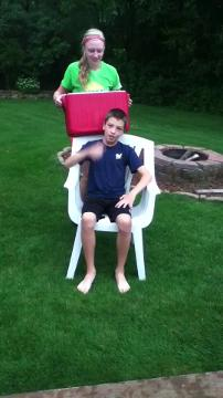 ALS Challenge Kollin Mangan, 11 gets drenched by his sister, Kourtney Mangan, 15. Both live in Sheboygan.