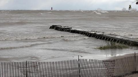 Intense waves and strong winds pound Sheboygan's shores