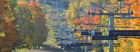 People enjoy taking fall ski lift rides Sunday morning, Oct. 12, 2014, at Granite Peak in Rib Mountain.